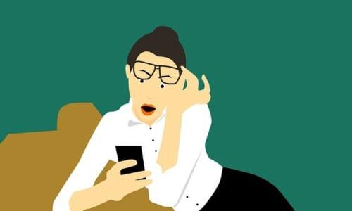 電話をみつめる女性のイラスト